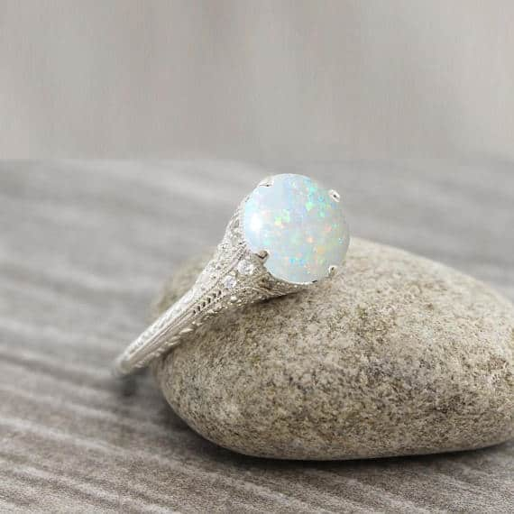 Opal and diamond art deco inspired engagement ring