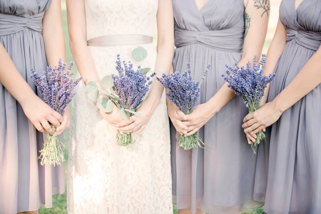 bridal party hold lavender bouquets