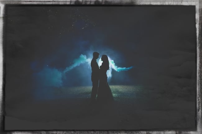 silhouette of newlyweds at night