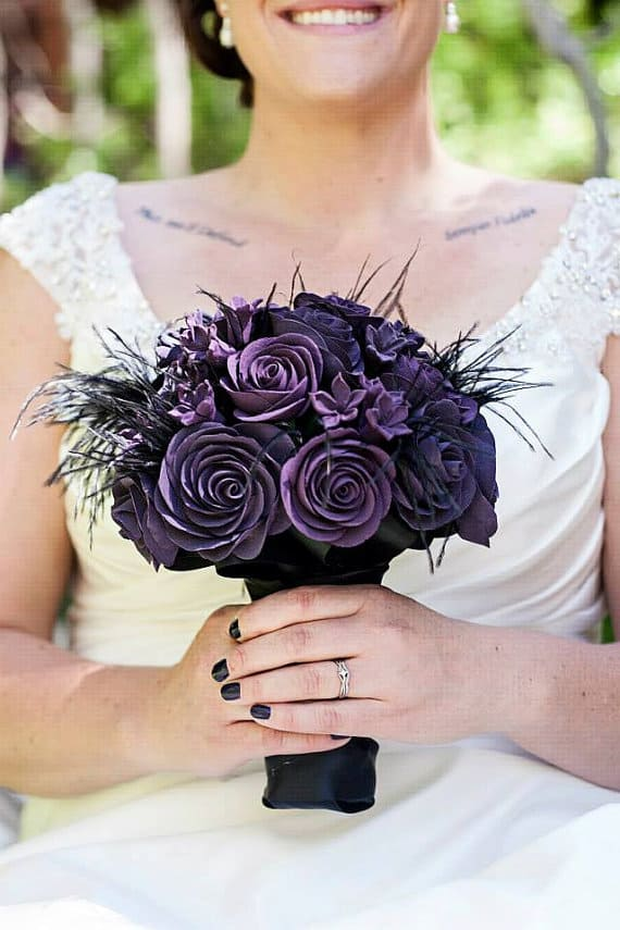 Gothic bridal bouquer with black feathers and purple flowers