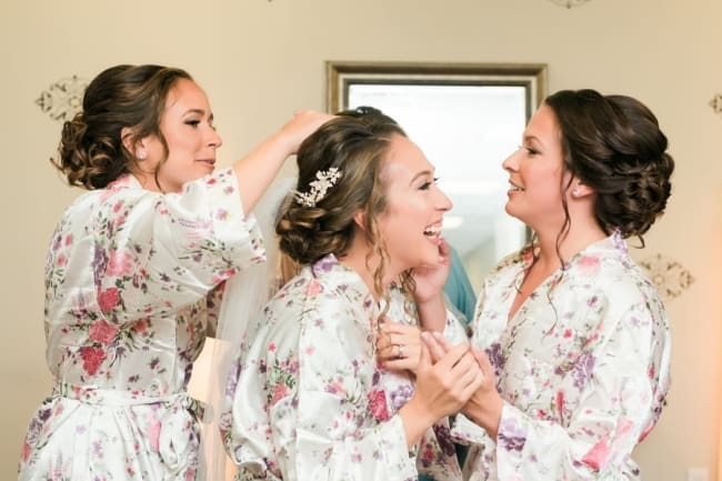 wedding morning bridal party getting ready in dressing gowns