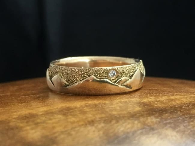 Mountain Range Design gold band with diamond inlay