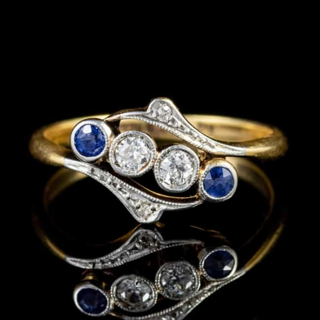 gold engagement ring with sapphires and diamonds