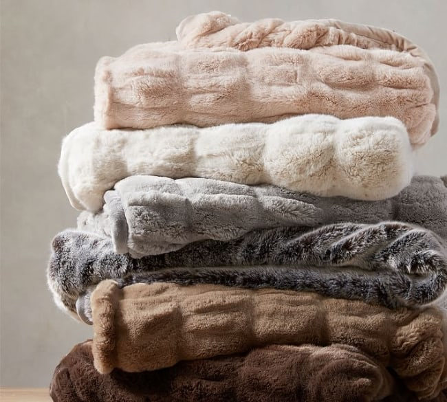 pile of faux fur throws