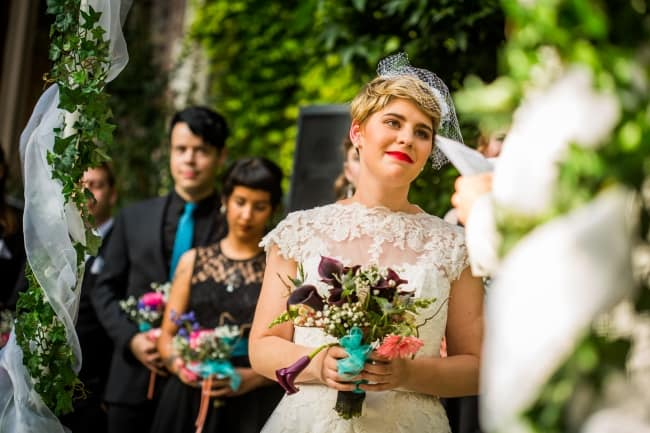 Peach and Turquoise Museum Wedding with Retro Punk Theme feature
