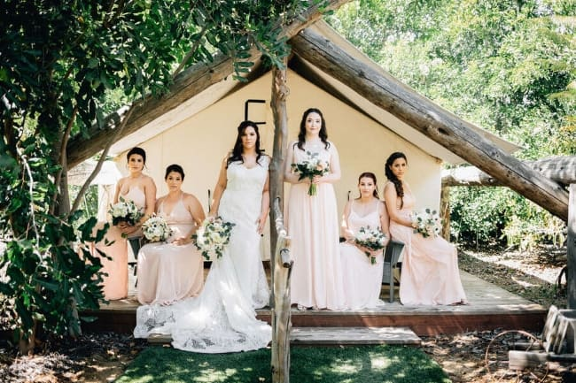 bridal-party-group-portrait-outdoor-tent-trademark-venues