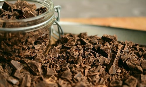 chunks of chocolate surrounding jar