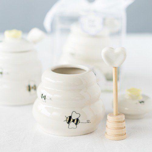 white porcelain honey pot and dipper