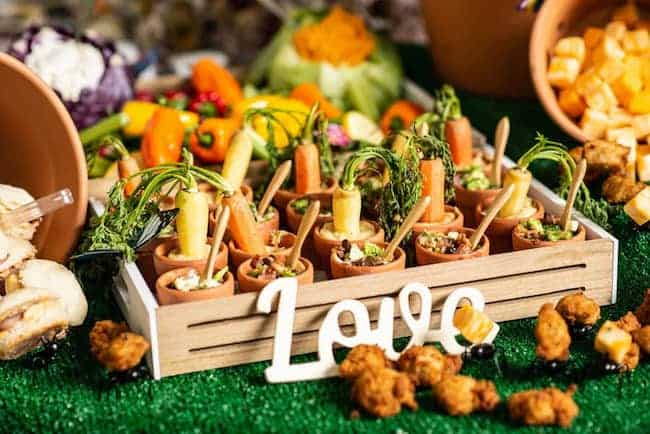 Carrot appetizers in terra cotta planters at wedding