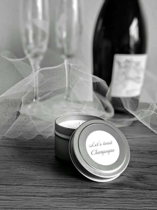 champagne scented candle in silver tin