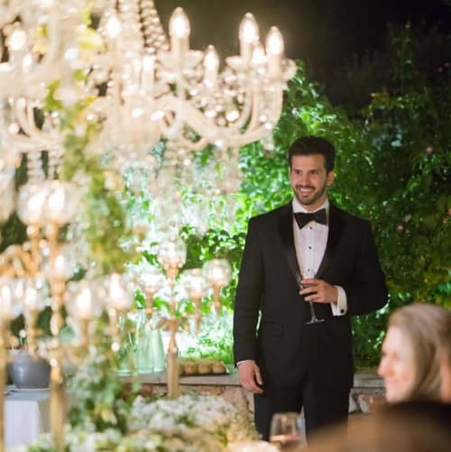 groom standing with champagne glass