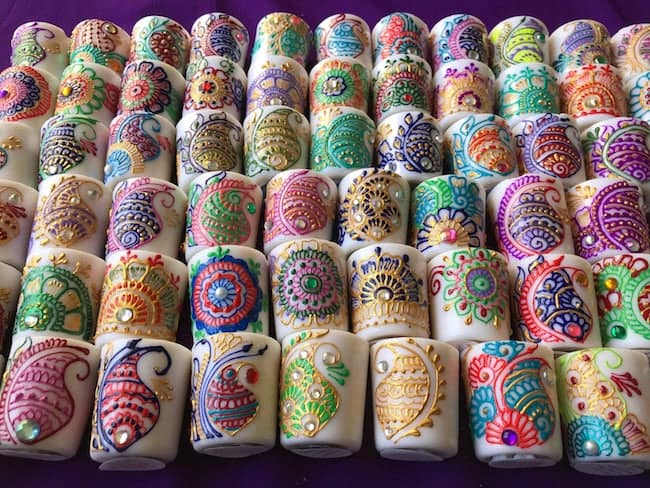 henna candles in multiple colors and rhinestone embellishments