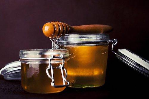 Honey in jars with wooden honey comb
