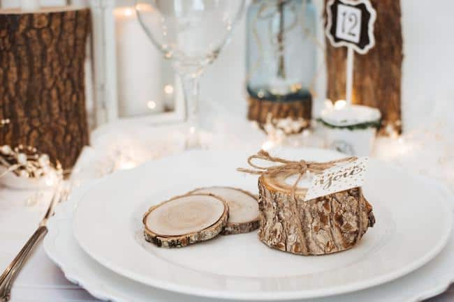 rustic wood candle holder on white plate