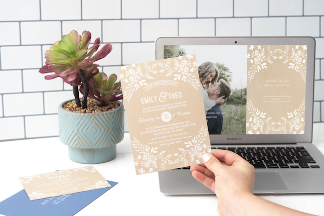 Floral print wedding invitation and laptop with RSVP by withjoy.com