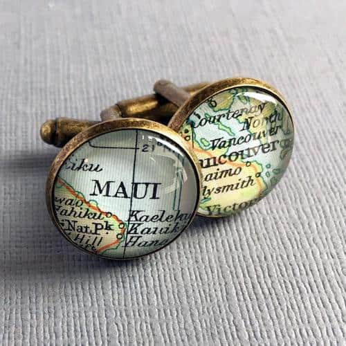 round cufflinks with maps of Maui and Vancouver