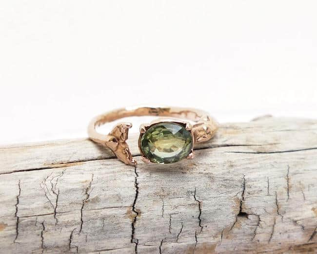 rose gold whale tale engagement ring with emerald stone