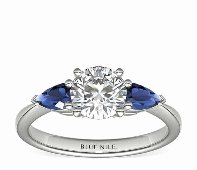 pear shaped engagement ring with sapphires and diamond