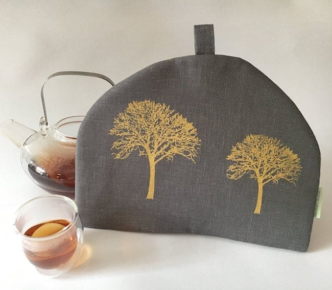 gray and gold tea cosy with tree print