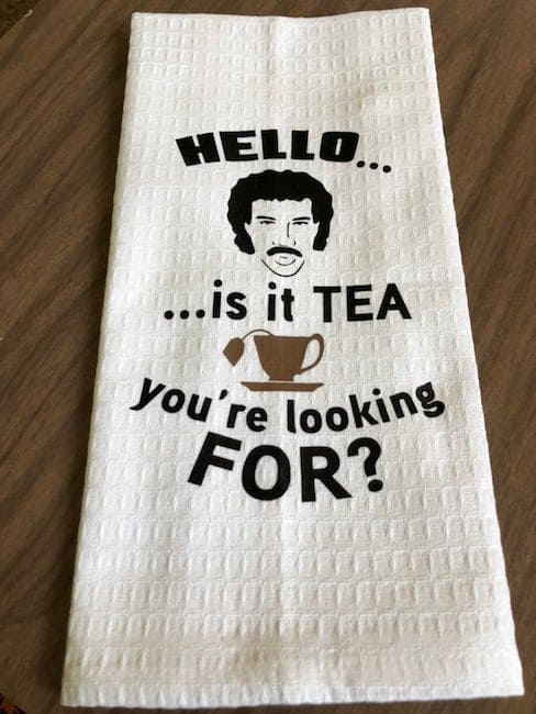 White tea towel with illustration of Mr. T and words