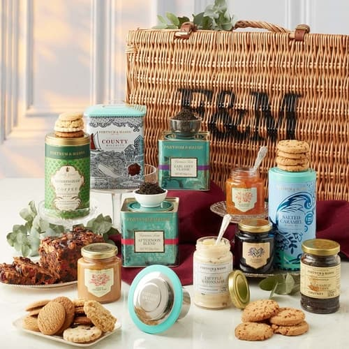 Picnic basket, cans of tea and jars of preserves