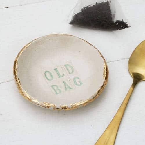Saucer for used tea bags with words 'Old Tea Bag'