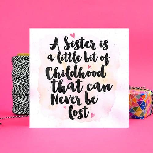 "gift card that says ""A sister is a little bit of childhood that can never be lost"""