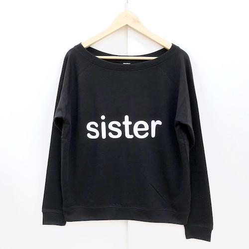 black sweatershirt with word sister in white font