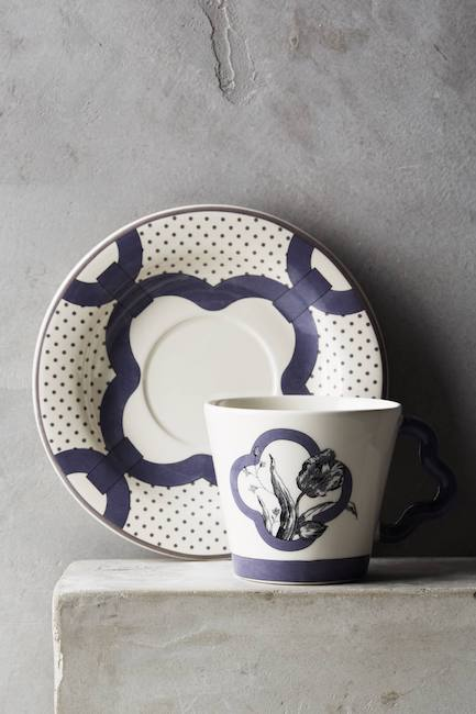 tea cup and saucer in white and blue design