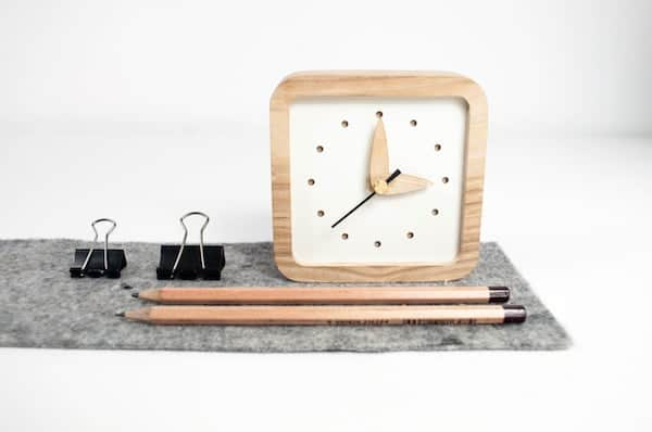 square desk clock with light wood frame and arms
