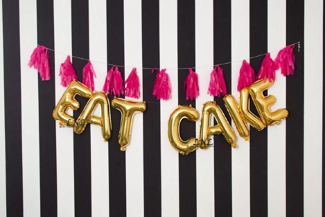 EAT CAKE gold letter balloons
