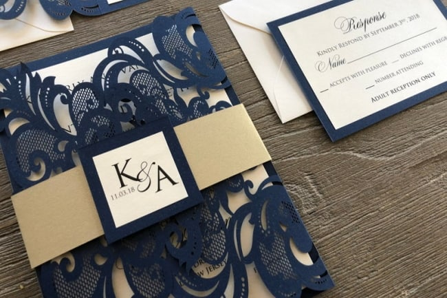 navy laser cut wedding invite