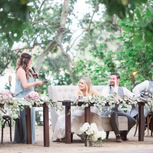 maid of honor giving speech to bride and groom