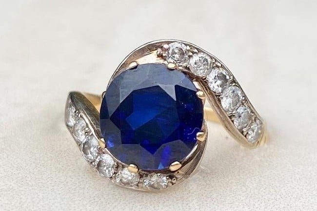 Antique Sapphire and Diamond Art Deco Swirl Ring